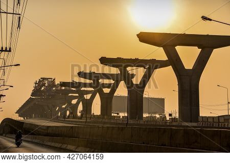 Silhouette Of An Expressway Under Construction, Expressway On Sunset Background