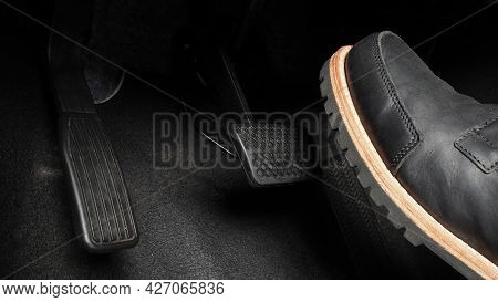 Man Foot And Accelerator And Brake Pedal Inside The Car