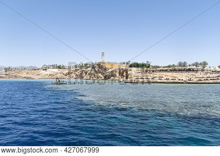 Beautiful Rocky Coast In The Resort Town Of Sharm El Sheikh, Egypt. View From The Sea. Egyptian Land