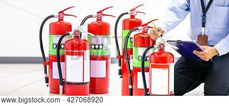 Fire Extinguisher, Firefighter Use Inspection List Checking Pressure Gauge Level Of Fire Extinguishe