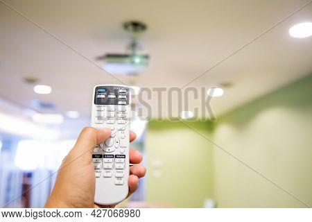 Remote Control Turn On Overhead Digital Projector Ceiling At Boardroom Or Meeting Room Or Seminar Te