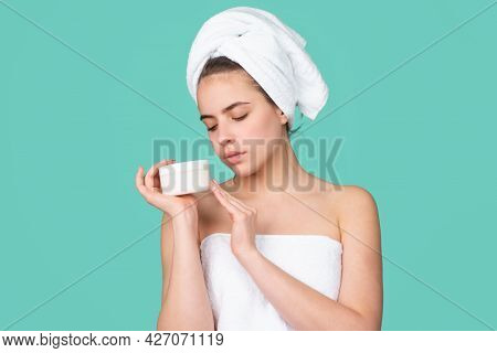 Portrait Of Attractive Young Girl With A Bath Towel On Head. Beautiful Woman Face Portrait.