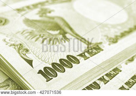Bundle Of 10,000 Yen Japanese Bills. Light Green Or Olive Tinted Backdrop. Background About Money, B