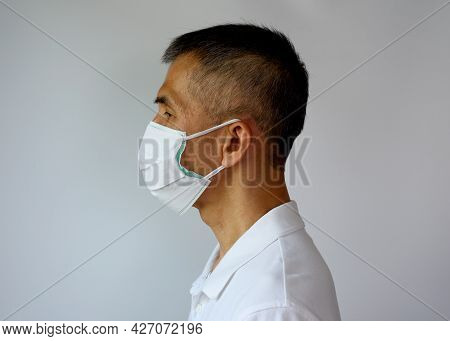Asian Senior Adult Man Wearing Double Face Mask, Cloth Mask And Medical Mask For Highly Covid-19 Pro