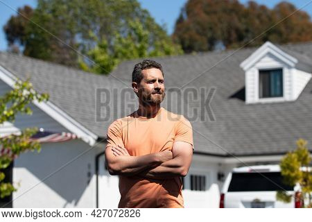Real Estate Manager. Happy Businessman Standing Outside Near His New Home. Suburban House.