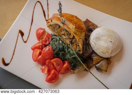 Image Of Pie With Vegetables, Fried Onions, Cherry Tomatoes And Baked Cheese