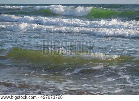Colored Sea Waves With Splashes And White Breakers In Circeo Park, Sabaudia, Italy