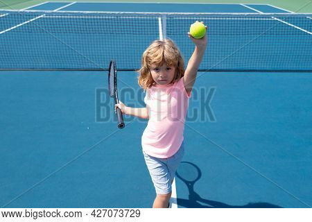 Little Boy Playing Tennis. Sport Kids. Child With Tennis Racket On Tennis Court. Training For Young