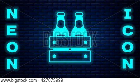 Glowing Neon Pack Of Beer Bottles Icon Isolated On Brick Wall Background. Wooden Box And Beer Bottle
