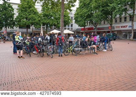 Group Of Young People With Bicycles On Square, Mostly Without Masks, During Second Year Of Coronavir