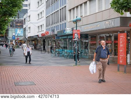 People On The Street Wearing Masks And Without Masks During The Second Year Of Coronavirus In Bonn,
