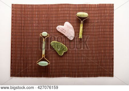 Rollers And Stones For Leather. Natural Stones For Smoothing The Skin. Cosmetic Tools On A Bamboo Ma