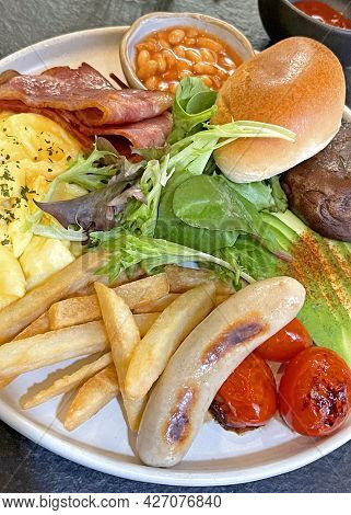 Traditional British All Day Breakfast Dish, Sausage, Bacon, Mushroom, Tomato, Bread, Egg, Fries And
