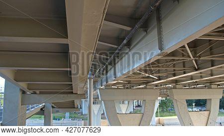 White Massive, Impressive Overpass Bridge . View From Beneath: Supporting Pillars Of The Constructio