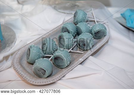Delicious And Tasty Sweets With Blue Garnishes From A Birthday Party