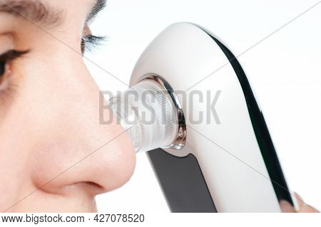 Facial Cleaning Theme. Woman Remove Blackheads From Skin Pores Macro Close Up View