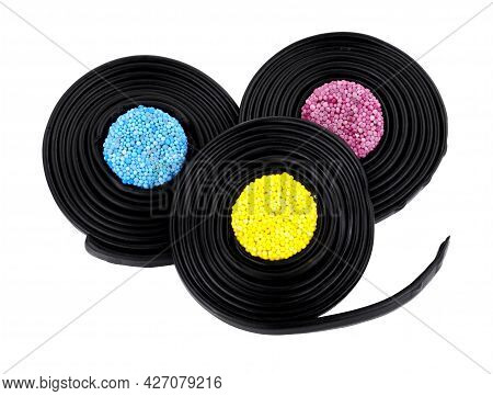 Liquorice Catherine Wheels, Soft Liquorice Strips Wrapped Around Jelly Buttons Isolated On A White B