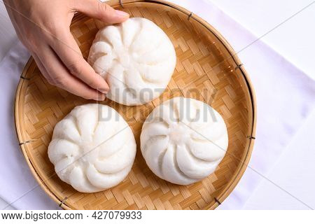 Steamed Bun Stuffed With Minced Pork On Bamboo Basket With Hand, Asian Food
