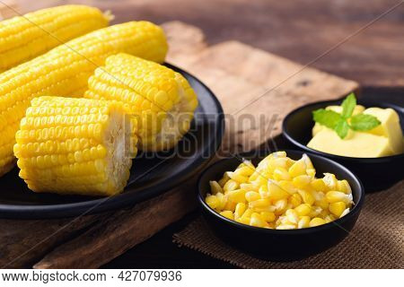 Sweetcorn And Butter In A Bowl On Wooden Background