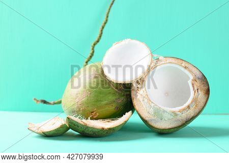Peeled Young Coconut Fruit On Green Color Background, Summer Tropical Fruit
