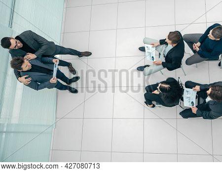 Boss Congratulating The Best Employee During A Work Meeting.