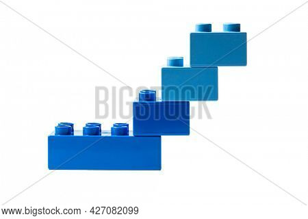 Blue plastic building blocks on white background