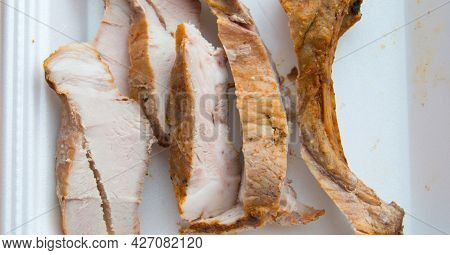 Close-up Of Sliced Pieces Of Cold Baked Pork In A Plastic Container
