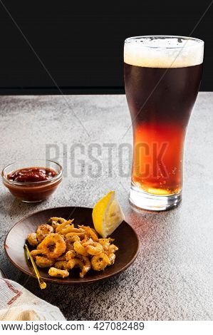 Serving Beer With Shrimps. Dark Beer And Fried Prawns. Beer With Foam.