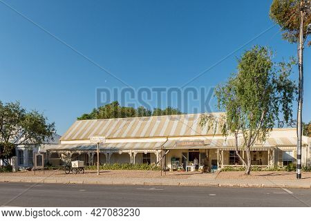 Prince Albert, South Africa - April 20, 2021: A Street Scene, With A Store In An Historic Building,
