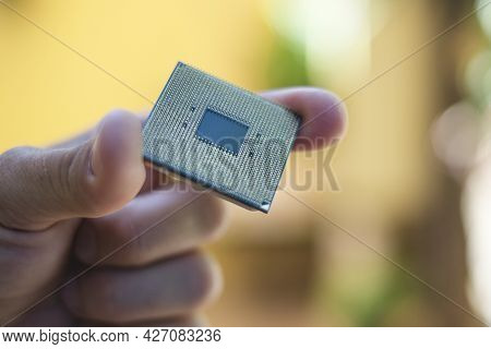 Man Hand While Hold A Desktop Pc Cpu Part, Computer Components Chip