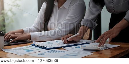 Close Up Asian Business Adviser Meeting To Analyze And Discuss The Situation On The Financial Report