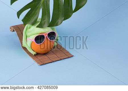 Creative Idea With Outstanding Blue Strawberry With Goggles And Fresh Ripe Strawberries On Pink Back