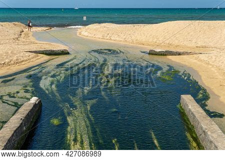 Mouth Of The Sant Jordi Irrigation Channel At The Beach Of Palma De Mallorca In The Mediterranean Se