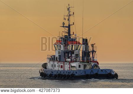 Tugboat - Auxiliary Ship Sails On The Sea At Sunrise