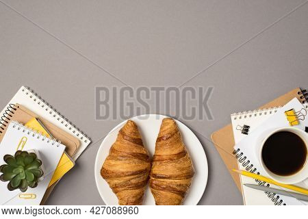 Top View Photo Of Workstation Stationery Stacks Of Notepads Binder Clips Pencil Pen Plant Cup Of Cof