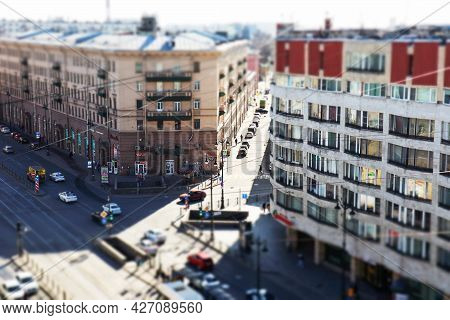 Top View Of A Street With High-rise Buildings, Roads And Cars On A Sunny Day, Tilt Shift Effect  - S
