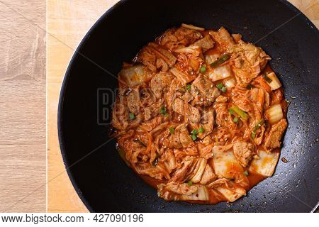 Stir-fried Pork With Kimchi Cabbage In Cooking Pan, Homemade Korean Food, Table Top View
