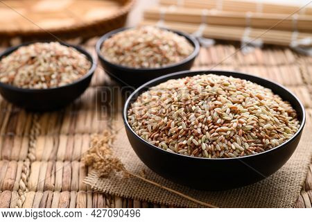 Organic Thai Highland Brown Rice Grain In A Bowl(cargo Rice, Loonzain Rice Or Husked Rice), Healthy