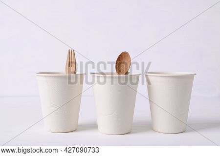 Biodegradable Coffee Cup Made From Natural Fiber With Wooden Fork And Spoon On White Background, Eco