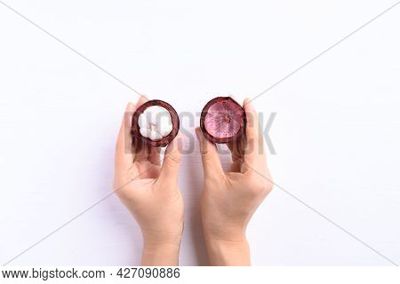 Peeled Mangosteen Fruit Holding By Hand On White Background Ready To Eating, Tropical Fruit