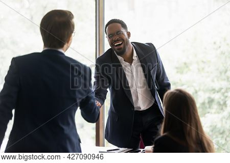 Happy Diverse Business Leader And Client Shaking Hands On Meeting