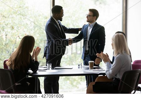 Happy African American Business Leader Shaking Hands With Promoted Employee