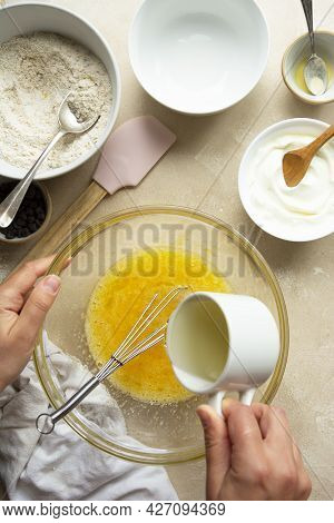 Pouring Oil Over Eggs In Glass Bowl. Cooking A Cake In Glass Bowl, Top View, Step By Step Recipe.