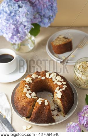 Traditional Bundt Cake, Homemade Pastry Baked Round Cake With Coffee Cup, Flowers On Background