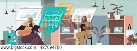 Arab Businesspeople Analyzing Statistic Data On Virtual Boards Successful Teamwork Concept