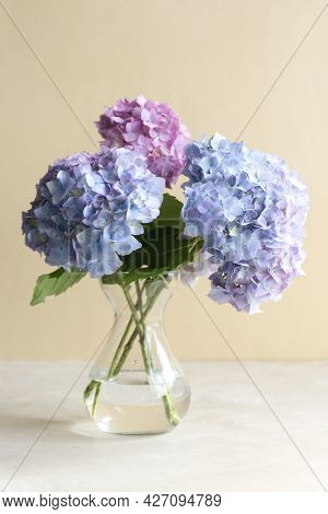 Blue Hydrangea Flower Bouquet In Glass Vase. Abstract Geeting Card.