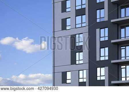 Construction Of Facade Part Of Modern Residential Apartment Building Against Cloudy Blue Sky As Copy