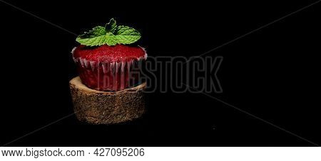 Closeup Of Delicious Red Velvet Cupcake Or Muffin Isolated In A Black Background With Copy Space And