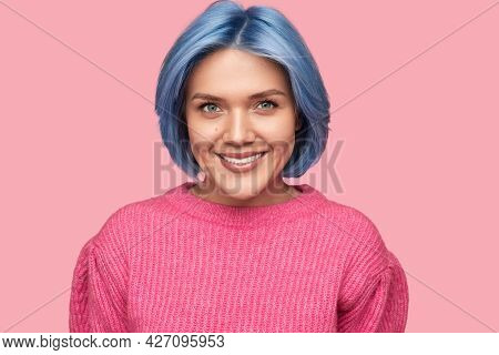 Cheerful Young Female With Short Dyed Hair Wearing Pink Knitted Sweater Smiling And Looking At Camer