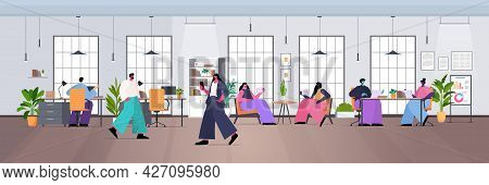 Businesspeople Team Working Together In Creative Coworking Area Modern Office Interior